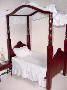 Wooden doll-size canopy bed