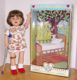 special needs doll with box background