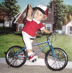 Boy doll riding a bicycle