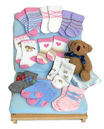 An array of designer doll socks for American girl dolls