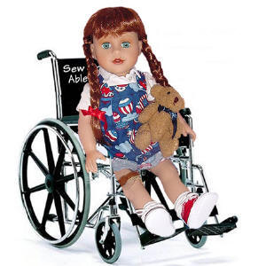 Handicapped doll in a wheelchair